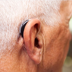 A person wearing a hearing aid in Titusville, FL